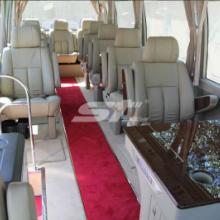 供应考斯特改装13座豪华商务车中巴车改装加装电动窗帘首长座椅批发