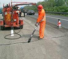 新技术沥青路面裂缝修复就选邯郸斯泰普力聚氨酯灌缝胶图片