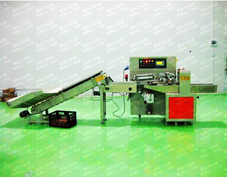 供应新科力柠檬包装机/单个柠檬自动包装机
